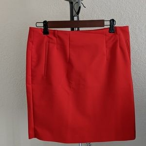 Red pencil skirt.